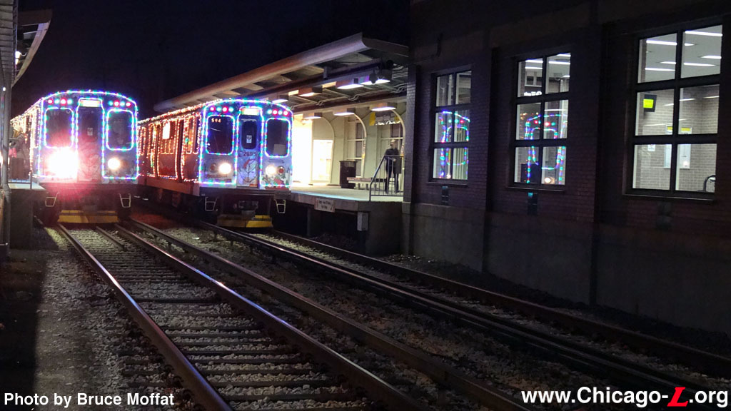 two of the three 2 car holiday trains providing service on the yellow line on the evening of december 23 2014 meet at dempster skokie station - Cta Christmas Train 2014