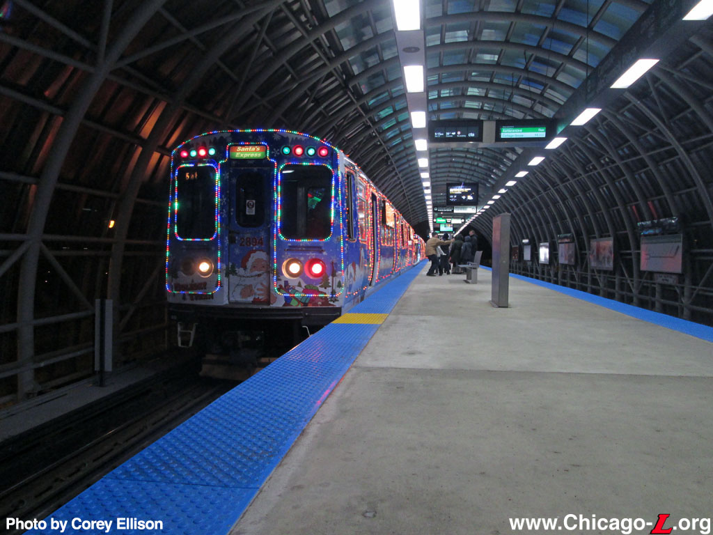 the cta holiday train with car 2894 in the lead stops at the cermak mccormick place station during the stops first holiday season in operation