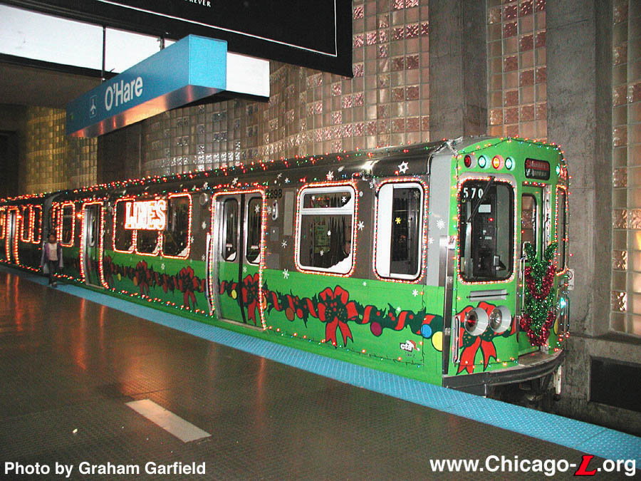 the cta holiday train led by car 2898 is parked at ohare terminal for the ctas employee appreciation day on december 6 2003 photo by graham garfield